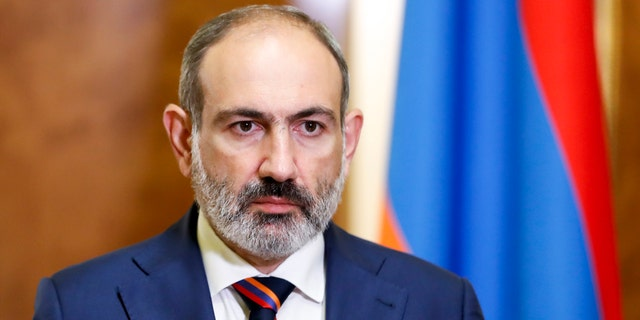 Armenian Prime Minister Nikol Pashinian pauses as he speaks at the Armenian parliament in Yerevan, Armenia, Sunday, Sept. 27, 2020.