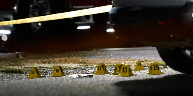 Evidence markers are placed on the ground Thursday, Sept. 3, 2020, in Lacey, Wash. at the scene where Michael Reinoehl was killed Thursday night as investigators moved in to arrest him.