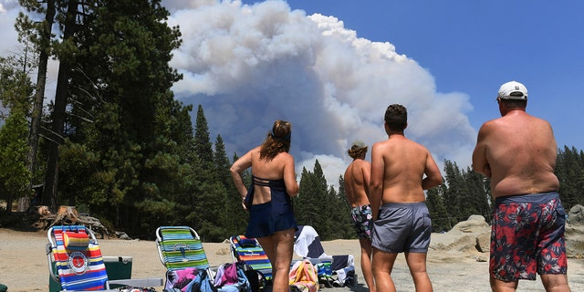A Ventura County family observes smoke from the Creek Fire from the shores of Shaver Lake, northeast of Fresno, California on Saturday, September 5, 2020.