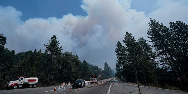Smoke from the Creek Fire billows in the sky during a road closure Monday, September 7, 2020 in Shaver Lake, California.