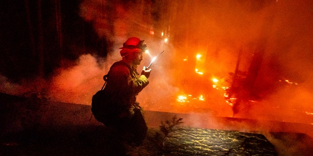 A firefighter fights the Creek Fire in the Shaver Lake community in Fresno County, California on Monday, September 7, 2020.