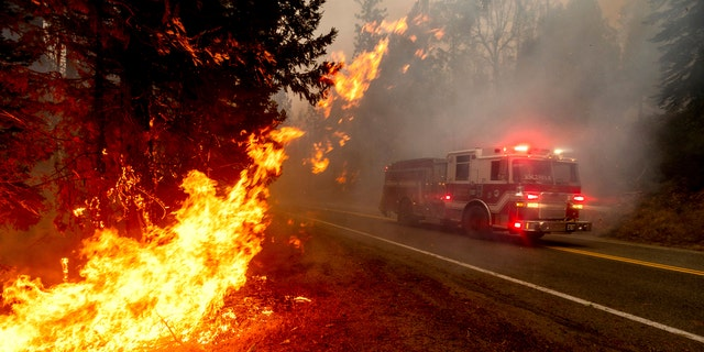 A fire truck drives along State Highway 168 along the Creek Fire in the Shaver Lake community of Fresno County, California on Monday, September 7, 2020.