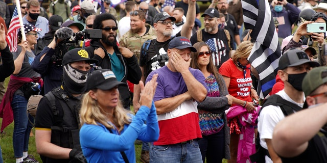 Members of the Proud Boys and other right-wing demonstrators rally, Saturday, Sept. 26, 2020, in Portland, Ore. (AP Photo/Allison Dinner)