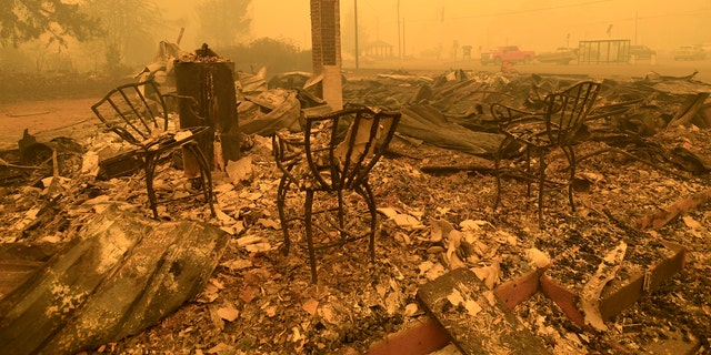 Three chairs are all that remain at the Gates post office in Gates, Ore., Wednesday, Sept 9, 2020. (Associated Press)