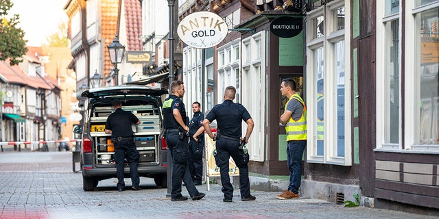 14 September 2020, Lower Saxony, Celle: Police task forces are protecting a crime scene in the city center. This afternoon, two gunmen attempted to rob a jewelry store. One of the perpetrators was killed, the other seriously injured. (Photo by Moritz Frankenberg / picture alliance via Getty Images)