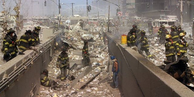 New York firefighters in 2001 amid the rubble of the World Trade Center following the 9/11 attacks (Universal History Archive/Universal Images Group via Getty Images)