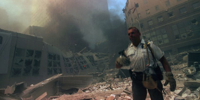A New York rescue worker amid the rubble of the World Trade Center following the 9/11 attacks. (Photo by: Universal History Archive/Universal Images Group via Getty Images)<br>