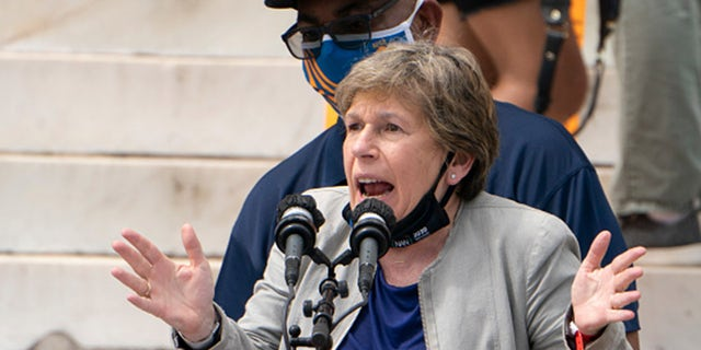 "Randi Weingarten, president of the American Federation of Teachers, speaks, along with Everett Kelley, left, National President of the American Federation of Government Employees, during the ""Commitment March: Get Your Knee Off Our Necks"" protest against racism and police brutality, on August 28, 2020, in Washington, DC. (Photo by Jacquelyn Martin / POOL / AFP)"