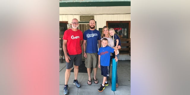 The Gillett family in front of Cressman's General Store with its previous owner Keith Davis.