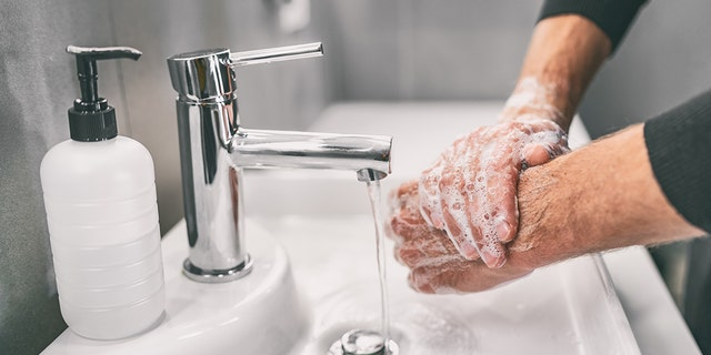 Washing hands rubbing with soap man for coronavirus prevention, hygiene to stop spreading coronavirus. (iStock)