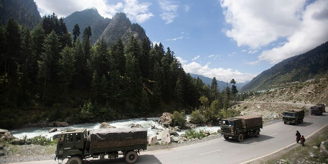 This Tuesday, September 1, 2020, an Indian army convoy is moving on the Srinagar-Ladakh highway in Gagangeer, northeast of Srinagar, Indian-controlled Kashmir.  (AP Photo / Mukhtar Khan, File)