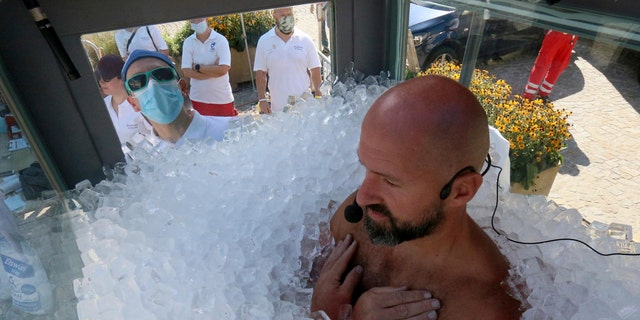 Chilling out: Austrian breaks record for standing in box of ice