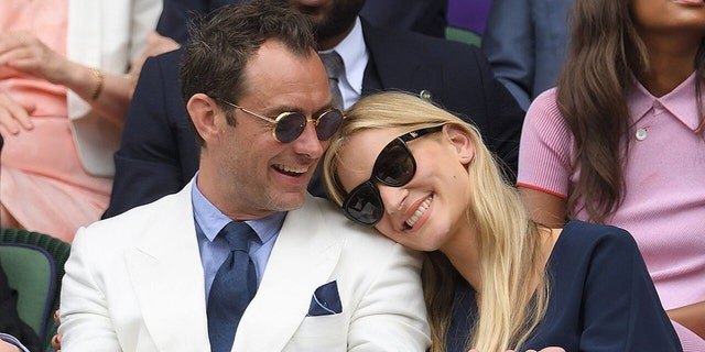 gardening Jude Law and Phillipa Coan attend day eleven of the Wimbledon Tennis Championships at Wimbledon on July 08, 2016 in London, England.