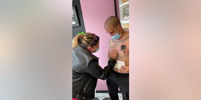 """Bruno Neves. from Great Yarmouth, U.K., popped the question to his girlfriend Patricia Calado with a tattoo that read """"Will you marry me?"""" (SWNS)"""