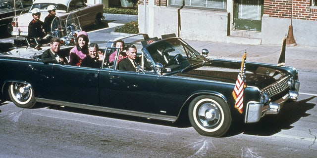The Kennedys and Connallys rode together through Dallas in the official SS-100-X limousine on Nov. 22, 1963. (Getty Images)
