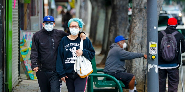 """Los Angeles County health officials announced 11 new coronavirus deaths on Sunday while pointing to a drop in hospitalizations to figures seen back in April.<br data-cke-eol=""""1""""> (Irfan Khan / Los Angeles Times via Getty Images)"""