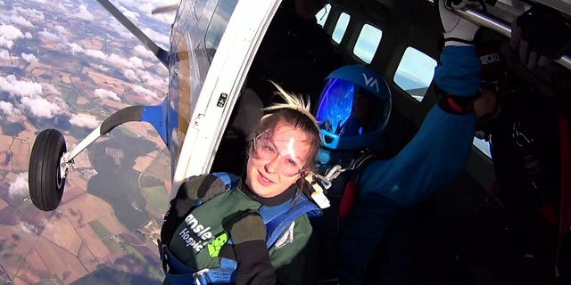 Jason Pack had planned ahead to create the ultimate romantic scene to top his girlfriend Katie Line's first-ever parachute jump. (SWNS)