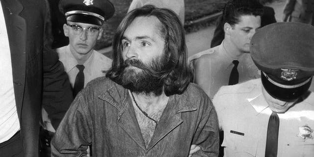 Charles Manson is escorted to court for a preliminary hearing on December 3, 1969, in Los Angeles, California.