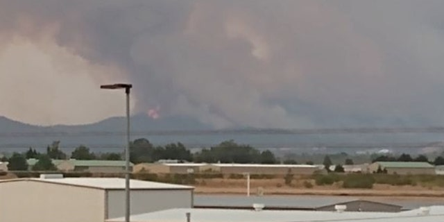 Smoke and flames from wildfires near Medford, Ore. on Tuesday, Sept. 8, 2020.