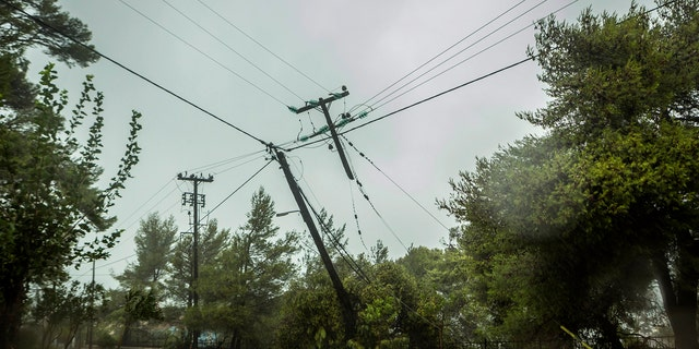 Damaged power and telecommunication lines are seen during a storm at the port of Argostoli, on the Ionian island of Kefalonia, western Greece, Friday, Sept. 18, 2020.