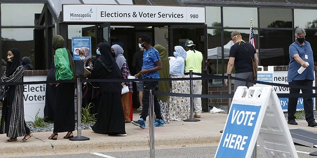 Minneapolis voters line up a day ahead of Minnesota's primary election in early August. (AP Photo/Jim Mone)