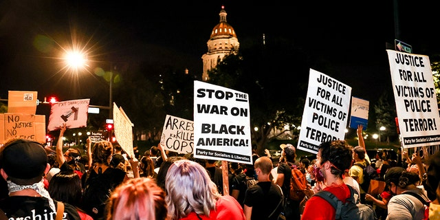 People protest the grand jury decision in the Breonna Taylor case in front of the Colorado Statehouse on Sept. 23, 2020, in Denver. (Getty Images)