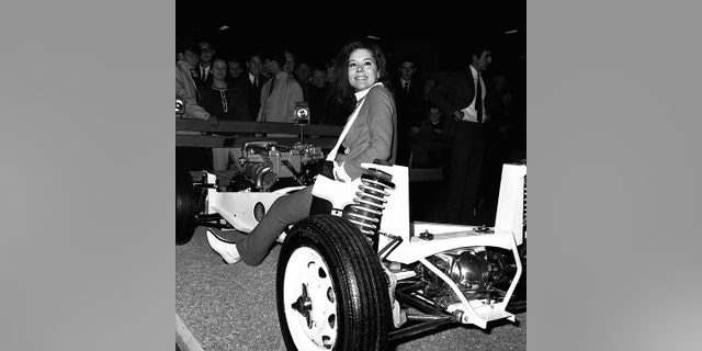 Rigg appeared on the Lotus stand at the 1965 Earl's Court Motor Show.