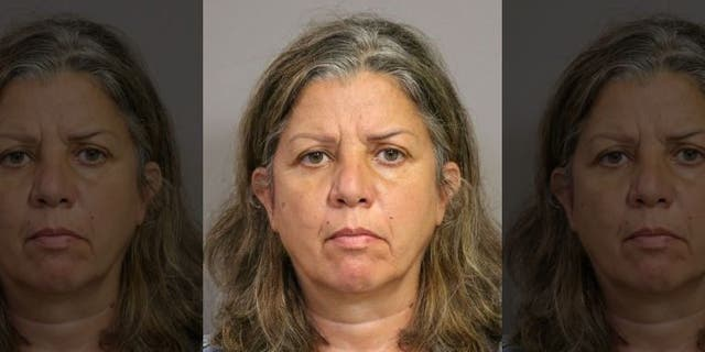 Rima Abikaram, 50, of Fullerton, Calif., was arrested on suspicion of elder abuse, authorities say. (Costa Mesa Police)