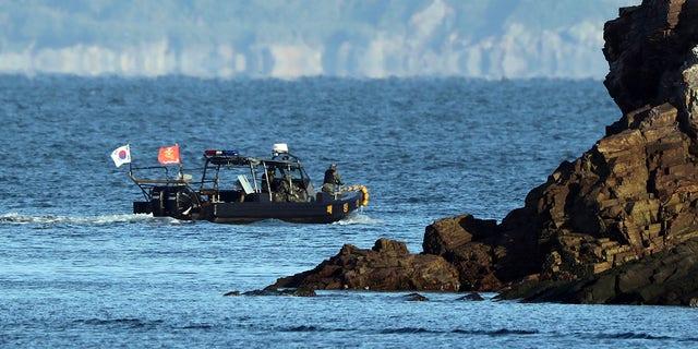 A South Korean navy boat patrols Sunday near Yeonpyeong Island, South Korea. (Baek Seung-ryul / Yonhap via AP)