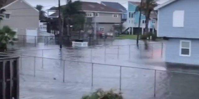Storm surge flooding can be seen in Jamaica Beach, Texas as Tropical Storm Beta nears the coast.