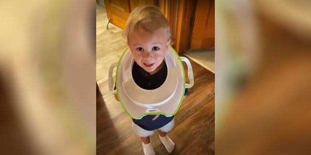 Abbie Paull said she only took her eyes off her son, Reuben, for a few seconds when he somehow got his training toilet stuck around his neck.