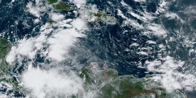 An area of disturbed weather over the Caribbean Sea could develop into a tropical system by the weekend, accoridng to forecasters.