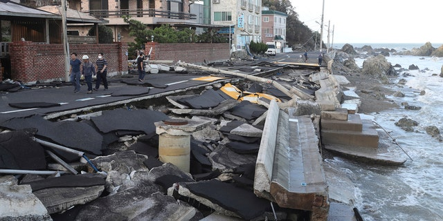 A coastal road is damaged in Ulsan, South Korea, Monday, Sept. 7, 2020.