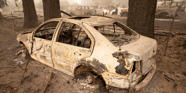 Flames from the Beachie Creek Fire melted the aluminum rims on a car near the destroyed Oregon Department of Forestry, North Cascade District Office in Lyons, Ore., Sunday, Sept. 13, 2020.
