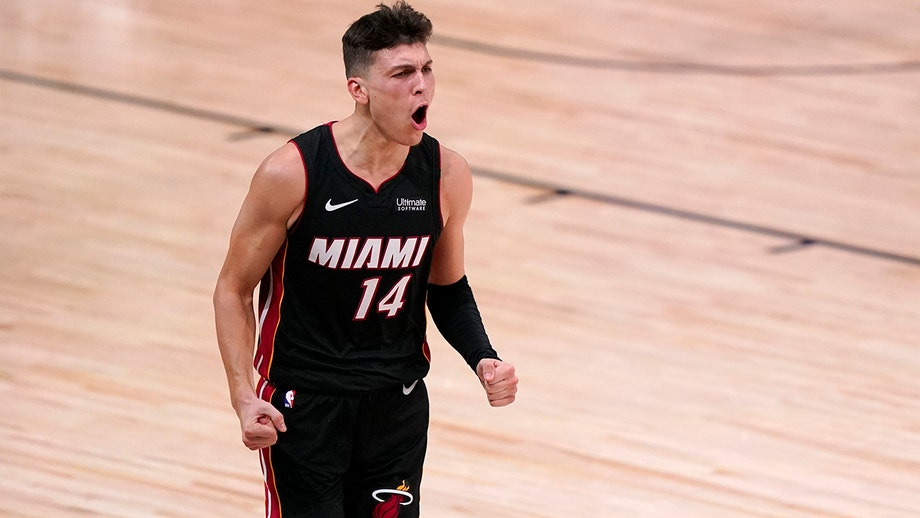 Heat top Celtics, move a game from NBA Finals