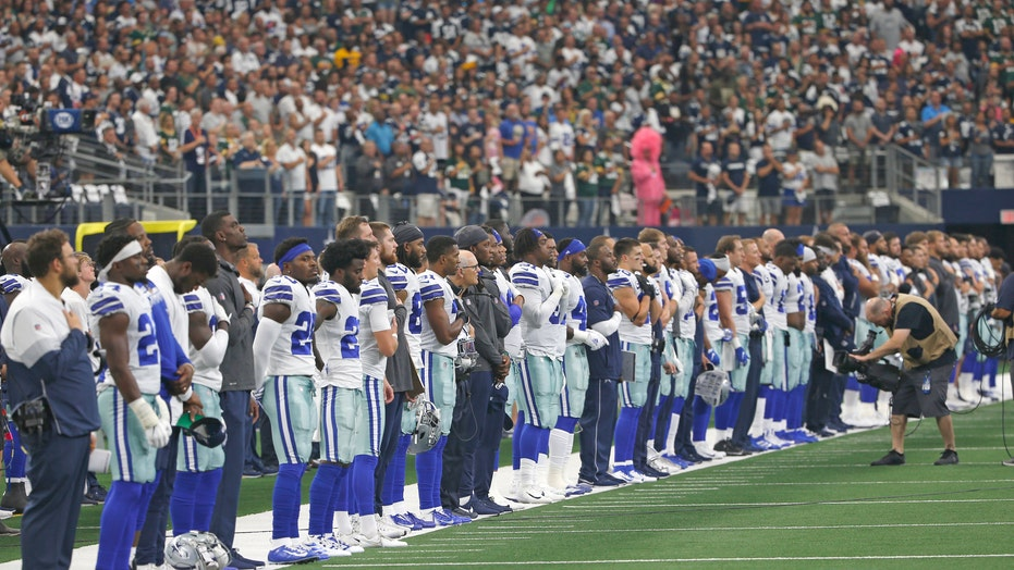 Cowboys players ponder kneeling during national anthem