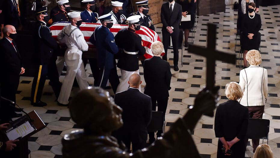 RBG's personal trainer pays homage with a casket-side pushup