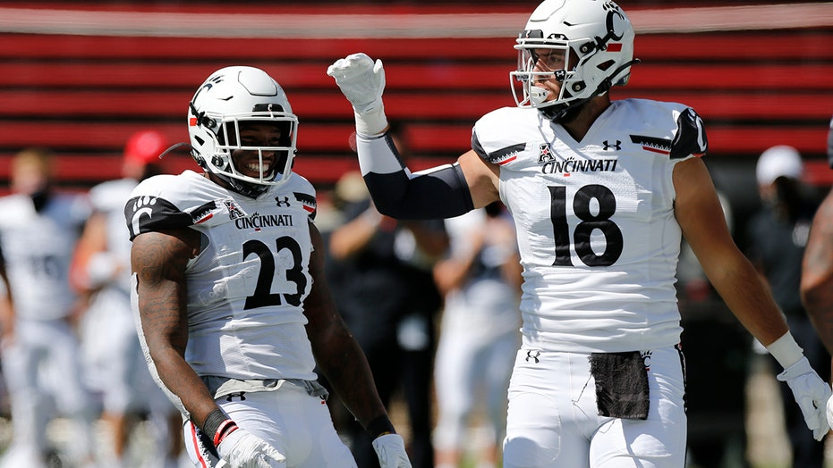 No. 13 Cincinnati rolls past Austin Peay 55-20 in opener