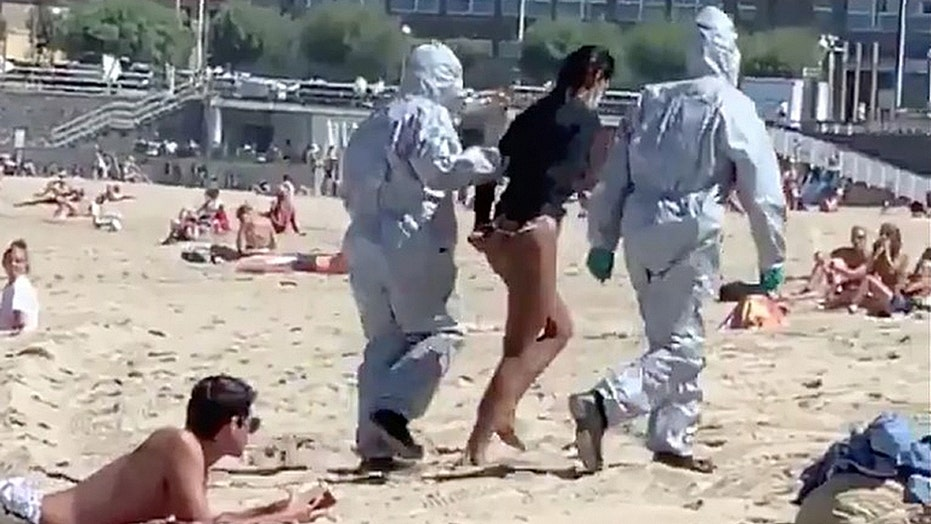 Surfer arrested at Spanish beach after police learn she had coronavirus,  was defying quarantine orders | Fox News