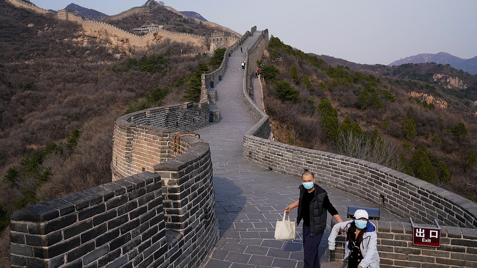 China's domestic tourists to Great Wall warned against climbing 'wild' sections during busy travel week