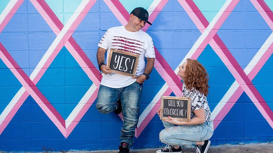 Divorced couple takes part in a photo shoot to celebrate the end of their marriage