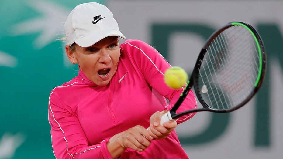 Former champ Halep reaches French Open 2nd round, Goffin out