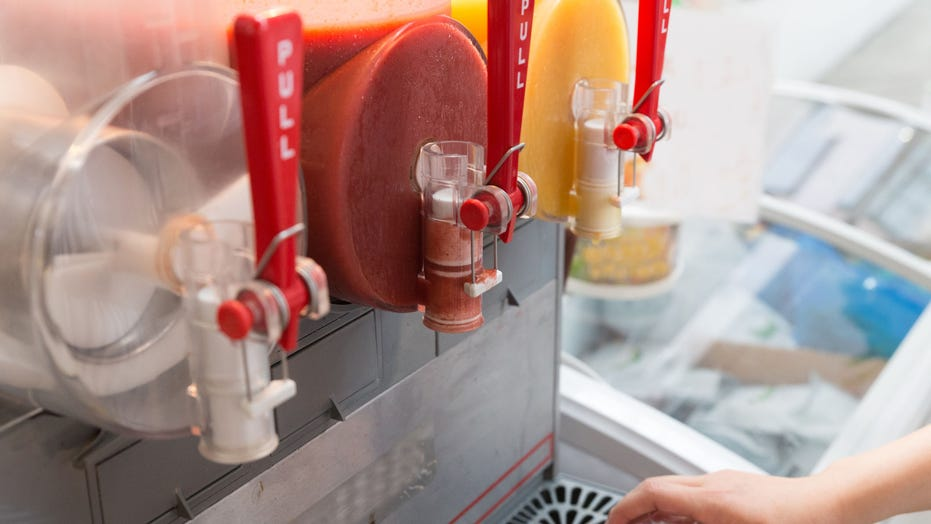 Elderly man mistakes frozen drink machine for hand-sanitizing station, washes up with red drink