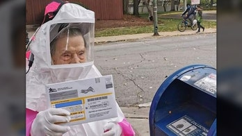 102-year-old woman dons hazmat suit to vote by mail