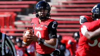 Ridder drives No. 7 Bearcats to 49-10 rout of Memphis