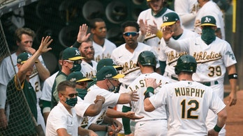 Pinder delivers timely hit, A's advance in playoffs at last