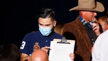 Arizona election officials scramble after judge extends voter registration deadline