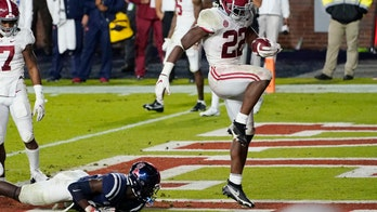 No. 2 Alabama beats Ole Miss 63-48 in record SEC outburst