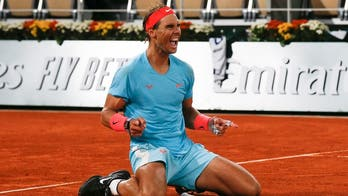Nadal beats Djokovic in straight sets at French open to win 20th Grand Slam