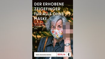 Berlin tourism department pulls controversial ad showing woman giving middle finger to those without masks